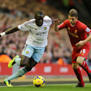 Liverpool's Jon Flanaghan, right, and West Ham United's Mohamed Diame battle for the ball during their English Premier League soccer match at Anfield, Liverpool, England, Saturday, Dec. 7, 2013