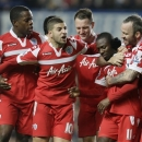 Queens Park Rangers' Shaun Wright-Phillips, second right, celebrates with teammates after scoring a goal against Chelsea during their English Premier League soccer match at Chelsea's Stamford Bridge stadium in London, Wednesday, Jan.  2, 2013. (AP Photo/Alastair Grant)
