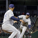 San Diego Padres first baseman Yonder Alonso flips the ball from his glove to pitcher Tyson Ross to get Cleveland Indians' Carlos Santana on a groundout in the third inning of the MLB baseball game Tuesday, April 8, 2014, in Cleveland The Associated Press