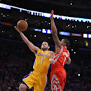 Los Angeles Lakers guard Jordan Farmar, left, puts up a shot as Houston Rockets guard Isaiah Canaan defends during the first half of an NBA basketball game, Tuesday, April 8, 2014, in Los Angeles The Associated Press