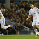 Real Madrid's James Rodriguez, right, and Karim Benzema go on the attack during the Champions League group B soccer match between Liverpool and Real Madrid at Anfield Stadium, Liverpool, England, Wednesday Oct. 22, 2014