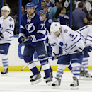 Toronto Maple Leafs right wing Phil Kessel (81), defenseman Jake Gardiner (51), and defenseman Morgan Rielly (44) react after Tampa Bay Lightning defenseman Victor Hedman (77), of Sweden, scored during the third period of an NHL hockey game Tuesday, April