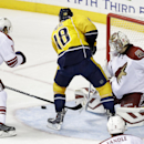 Arizona Coyotes goalie Devan Dubnyk (40) blocks a shot by Nashville Predators left wing James Neal (18) in the first period of an NHL hockey game Tuesday, Oct. 21, 2014, in Nashville, Tenn. Defending at left is Shane Doan (19) The Associated Press