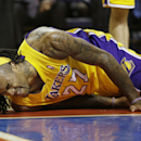 Los Angeles Lakers center Jordan Hill (27) reacts after falling to the floor during the second half of an NBA basketball game against the Detroit Pistons at the Palace in Auburn Hills, Mich., Friday, Nov. 29, 2013 The Associated Press