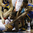 Golden State Warriors center Andrew Bogut, top left, and forward Harrison Barnes, right, reach in as Detroit Pistons forward Greg Monroe tries controlling a loose ball during the second half of an NBA basketball game in Auburn Hills, Mich., Monday, Feb. 2