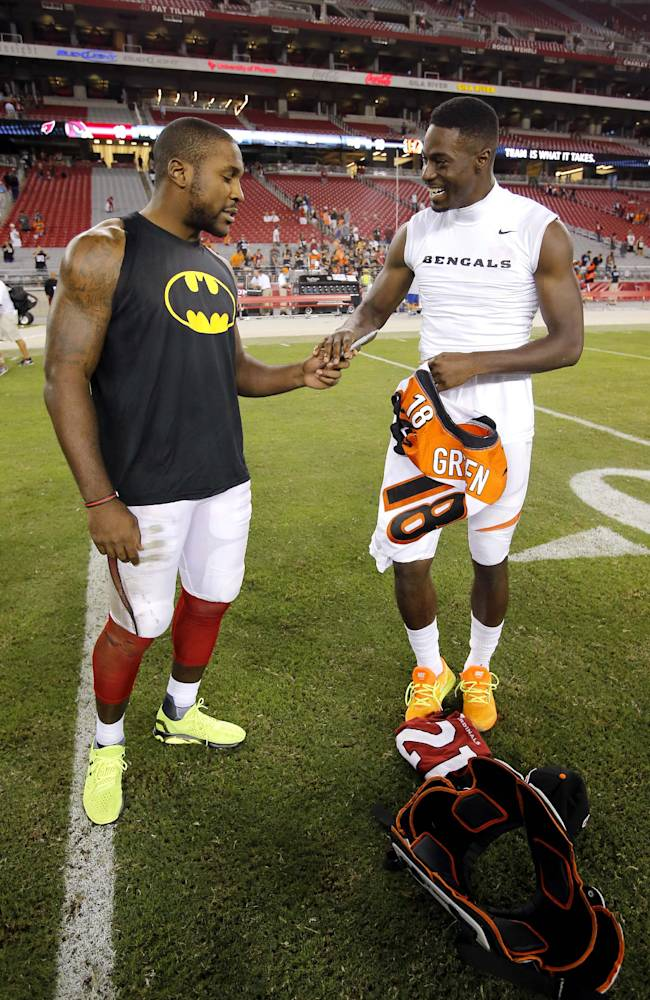 Arizona Cardinals cornerback Patrick Peterson, left, and Cincinnati Bengals wide receiver A.J. Green exchange jerseys after an NFL preseason football game, Sunday, Aug. 24, 2014, in Glendale, Ariz. The Bengals won 19-13