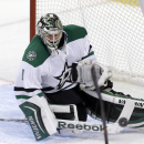 Dallas Stars goalie Jack Campbell (1) stops a shot by the Florida Panthers in the second period of an NHL hockey preseason game, in Sunrise, Fla., Wednesday, Sept. 24, 2014. The Stars won 4-3 in a shootout. The Associated Press