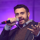 TV presenter Adam Richman speaks to the crowd on stage during the NFL Fan Rally in Trafalgar Square, London, England, Saturday, Oct. 25, 2014. The Atlanta Falcons will play the Detroit Lions in an NFL football game at London's Wembley Stadium on Sunday Oc