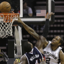 San Antonio Spurs' Kawhi Leonard (2) goes to the basket over Atlanta Hawks' Paul Millsap (4) during the second half of an NBA basketball game, Monday, Dec. 2, 2013, in San Antonio. San Antonio won 102-100 The Associated Press