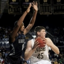 Notre Dame forward Jack Cooley, right, tries to drive the lane as Georgetown forward Mikael Hopkins defends during the first half of an NCAA college basketball game, Monday Jan. 21, 2013, in South Bend, Ind. (AP Photo/Joe Raymond)