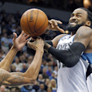 Minnesota Timberwolves center Ronny Turiaf, right, is fouled by Indiana Pacers guard George Hill during the second period of their NBA basketball game, Wednesday, Feb. 19, 2014 in Minneapolis The Associated Press