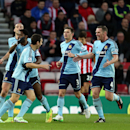 West Ham United's Stewart Downing, left, celebrates his goal with his teammates during their English Premier League soccer match against Sunderland at the Stadium of Light, Sunderland, England, Saturday, Dec. 13, 2014