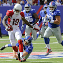 Arizona Cardinals Ted Ginn (19) breaks a tackle by New York Giants' Steve Weatherford (5) on his way to a touchdown during the second half of an NFL football game Sunday, Sept. 14, 2014, in East Rutherford, N.J The Associated Press
