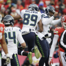 Seattle Seahawks wide receiver Doug Baldwin (89) celebrates his touchdown against the Kansas City Chiefs with quarterback Russell Wilson (3) in the first half of an NFL football game in Kansas City, Mo., Sunday, Nov. 16, 2014 The Associated Press
