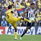Monterrey's Jesus Zavala, right, fights for the ball with America's Jesus Molina during a semifinal match of the Mexican soccer league in Mexico City, Saturday, May 18, 2013. (AP Photo/Christian Palma)