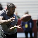 Running back Marcus Lattimore makes a catch during South Carolina's NFL football pro day on Wednesday, March 27, 2013 in Columbia, S.C. (AP Photo/Rainier Ehrhardt)
