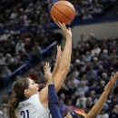 Connecticut's Stephanie Dolson, left, drives past Syracuse's Carmen Tyson-Thomas during the first half of an NCAA college basketball game in Hartford, Conn., Saturday, Jan. 19, 2013. (AP Photo/Fred Beckham)