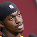 Washington Redskins quarterback Robert Griffin III, speaks during a media availability at their NFL football training facility, Wednesday, Dec. 11, 2013, in Ashburn, Va. Kirk Cousins will start for the Redskins on Sunday, and Griffin III will be the No. 3 quarterback behind Rex Grossman. (AP Photo/Alex Brandon)