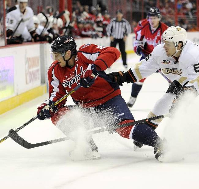 Anaheim Ducks defenseman Ben Lovejoy (6) battles for the puck against Washington Capitals right wing Alex Ovechkin, of Russia, during the first period an NHL hockey game, Monday, Dec. 23, 2013, in Washington