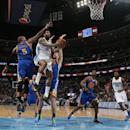 Denver Nuggets forward Wilson Chandler, seconf from left, drives lane for shot as, from left, Golden State Warriors forward Marreese Speights, center Ognjen Kuzmic, of Bosnia, and forward Harrison Barnes cover while Nuggets forward Kenneth Faried looks on