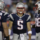 New England Patriots quarterback Tim Tebow (5) stands before huddling with teammates during the fourth quarter of an NFL preseason football game against the New York Giants Thursday, Aug. 29, 2013, in Foxborough, Mass. (AP Photo/Mary Schwalm)