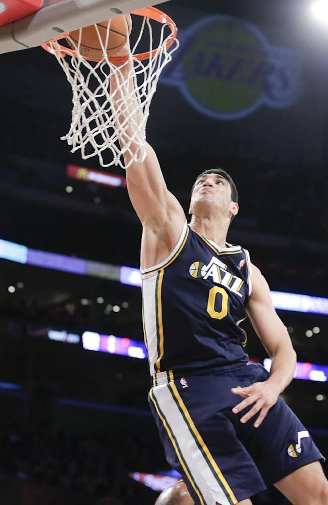 Utah Jazz center Enes Kanter dunks against the Los Angeles Lakers during the first half of a NBA preseason basketball game in Los Angeles, Tuesday, Oct. 22, 2013