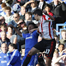 Chelsea's Willian, left, fights for the ball with Sunderland's Santiago Vergini during their English Premier League soccer match at the Stamford Bridge ground in London, Saturday April 19, 2014. Sunderland won the match 2-1