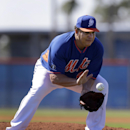 New York Mets pitcher Bartolo Colon fields a grounder during spring training baseball practice, Monday, Feb. 17, 2014, in Port St. Lucie, Fla The Associated Press