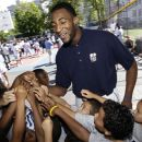 NBA Draft prospect Andre Drummond gathers with youngsters during an NBA fitness clinic at the Children's Aid Society Dunlevy Milbank Boys & Girls Club in the Harlem section of New York, Wednesday, June 27, 2012. (AP Photo/Kathy Willens)
