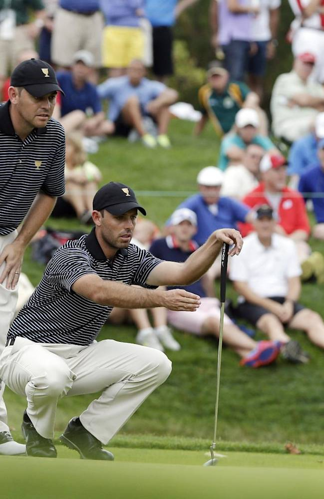 US keeps lead as rain interrupts Presidents Cup