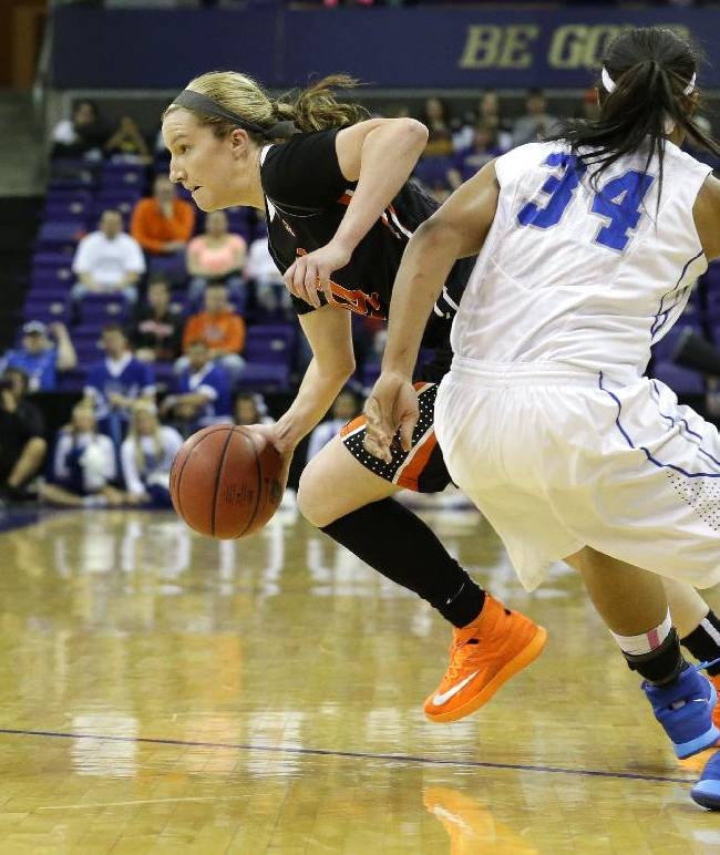 Oregon State's Ali Gibson, left, gets away from Middle Tennessee State's Olivia Jones (34) in the second half of a first-round game in the NCAA women's college basketball tournament, Sunday, March 23, 2014, in Seattle. Oregon State beat Middle Tennessee State 55-36