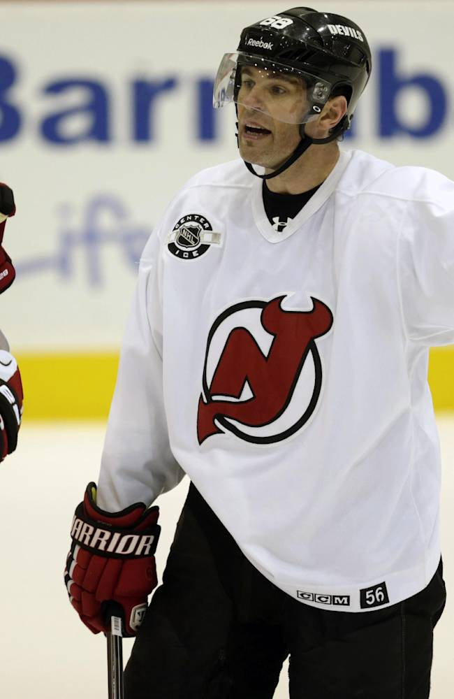 New Jersey Devils right wing Jaromir Jagr, right, of the Czech Republic, talks to Travis Zajac during NHL hockey training camp, Friday, Sept. 19, 2014, in Newark, N.J