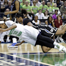 Notre Dame's Jewell Loyd, front, is knocked down by Duke's Richa Jackson, back, during the first half of the NCAA college basketball championship game of the Atlantic Coast Conference tournament in Greensboro, N.C., Sunday, March 9, 2014. (AP Photo/Chuck Burton)