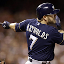 In this Aug. 30, 2014, file photo, Milwaukee Brewers' Mark Reynolds hits a single off San Francisco Giants' Jake Peavy in the eighth inning of a baseball game in San Francisco. Reynolds, a free agent, signed with the St. Louis Cardinals this offseason. T
