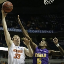 Florida's Erik Murphy (33) heads to the basket as LSU forward Shavon Coleman (5) defends during the first half of an NCAA college basketball game at the Southeastern Conference tournament, Friday, March 15, 2013, in Nashville, Tenn. (AP Photo/Dave Martin)