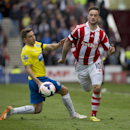Stoke City's Marko Arnautovic, right, fights for the ball against Newcastle United's Dan Gosling during their English Premier League soccer match at the Britannia Stadium, Stoke, England, Saturday April 12, 2014