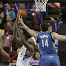 Sacramento Kings center DeMarcus Cousins, left, and Minnesota Timberwolves center Nikola Pekovic, of Montenegro, go for a rebound during the third quarter of an NBA basketball game in Sacramento, Calif., Saturday, March 1, 2014. The Timberwolves won 108-