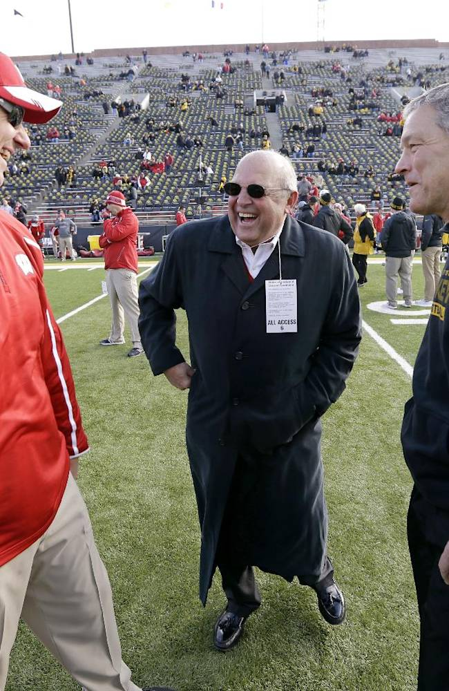Wisconsin head coach Gary Andersen, left, and athletic director Barry Alvarez, center, talk with Iowa head coach Kirk Ferentz, right, before an NCAA college football game, Saturday, Nov. 2, 2013, in Iowa City, Iowa