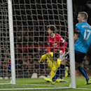 Stoke's Ryan Shawcross, right, reacts as Manchester United's Marouane Fellaini, upper centre, scores during the English Premier League soccer match between Manchester United and Stoke City at Old Trafford Stadium, Manchester, England, Tuesday Dec. 2, 2014