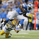 Detroit Lions running back Reggie Bush (21) jumps over Green Bay Packers free safety Micah Hyde (33) during the first half of an NFL football game in Detroit, Sunday, Sept. 21, 2014 The Associated Press