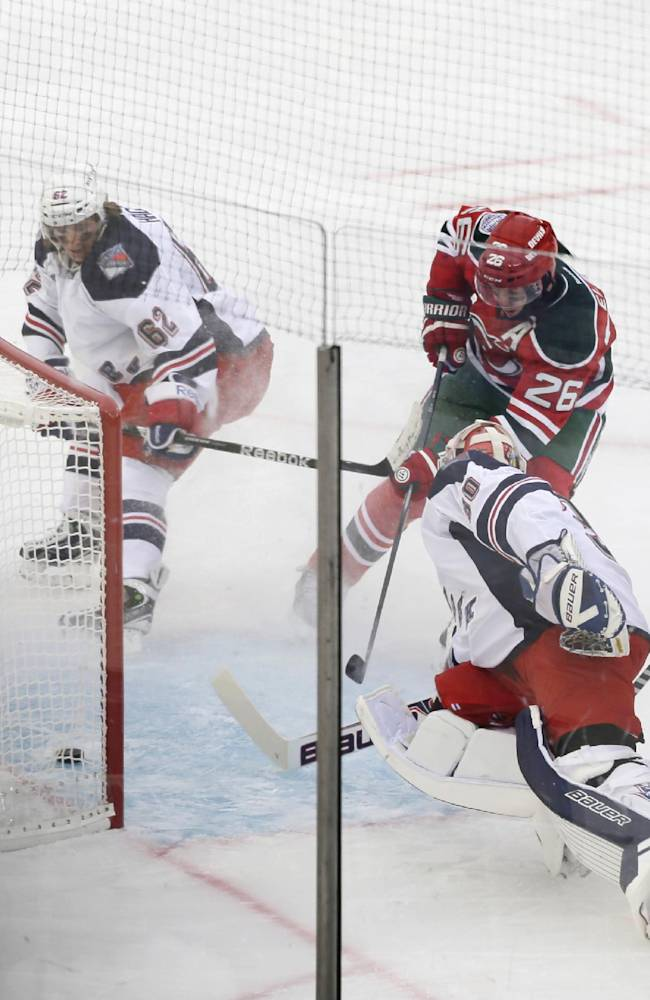 New Jersey Devils left wing Patrik Elias (26) shoots the puck past New York Rangers goalie Henrik Lundqvist (30), of Sweden, during the first period of an outdoor NHL hockey game between the New Jersey Devils and the New York Rangers Sunday, Jan. 26, 2014, at Yankee Stadium in New York
