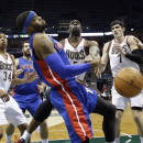 Milwaukee Bucks' Ekpe Udoh knocks the ball away from Detroit Pistons' Andre Drummond during the first half of an NBA basketball game on Wednesday, Dec. 4, 2013, in Milwaukee. (AP Photo/Morry Gash)