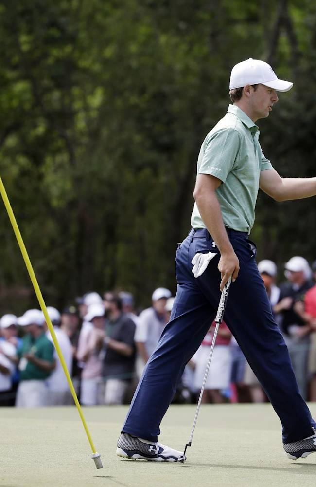 Jordan Spieth holds up his ball after a birdie on the sixth hole during the fourth round of the Masters golf tournament Sunday, April 13, 2014, in Augusta, Ga