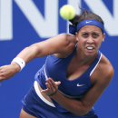 Madison Keys of the United States serves against Lucie Safarova of the Czech Republic during their first round match of the Pan Pacific Open Tennis tournament in Tokyo, Monday, Sept. 15, 2014. (AP Photo/Koji Sasahara)