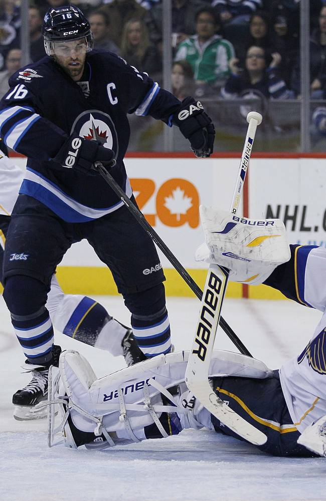 Jets down Blues 4-3 in SO after Trouba injured