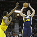 Utah Jazz's Gordon Hayward, right, shoots against Cleveland Cavaliers' Tristan Thompson, from Canada, during the second quarter of an NBA basketball game on Friday, Feb. 28, 2014, in Cleveland. Hayward scored 18 points for Utah. Cleveland defeated Utah 99