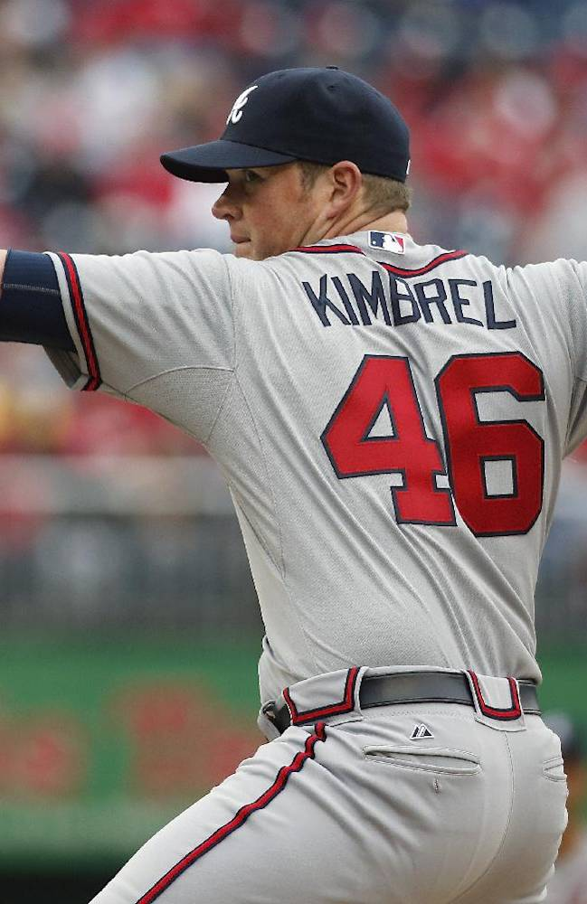 Atlanta Braves relief pitcher Craig Kimbrel throws during the ninth inning of a baseball home opener against the Washington Nationals at Nationals Park, Friday, April 4, 2014, in Washington. The Braves defeated the Nationals 2-1