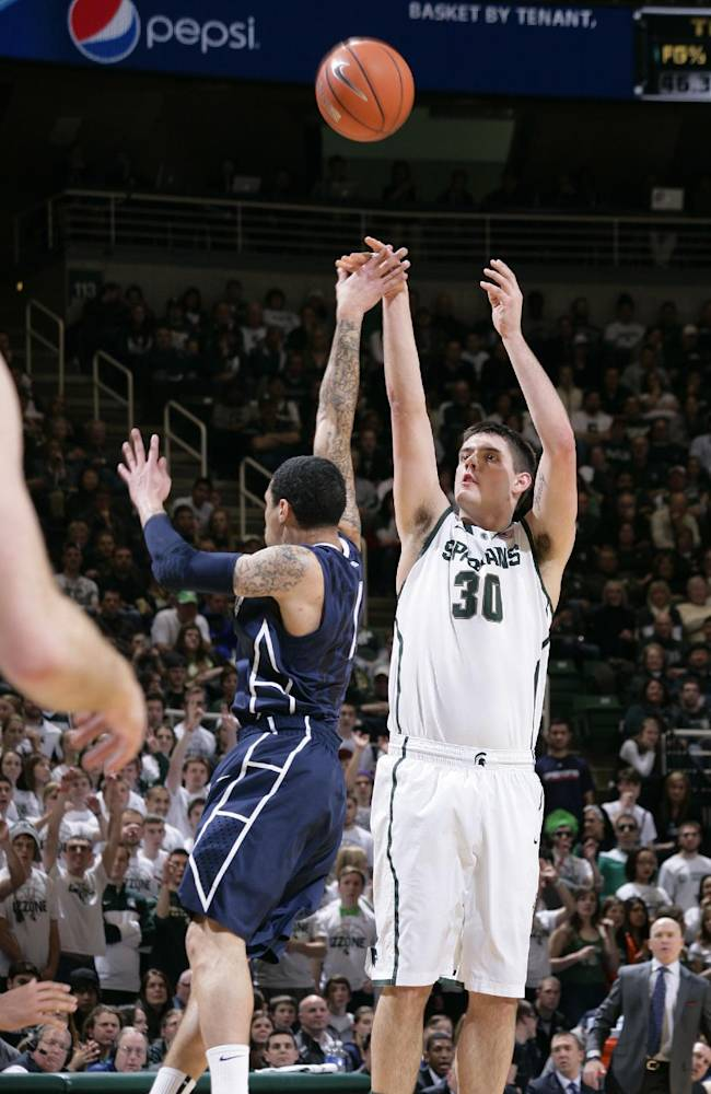 Michigan State's Kenny Kaminski (30) shoots a 3-point basket against Penn State's John Johnson during the second half of an NCAA college basketball game onThursday, Feb. 6, 2014, in East Lansing, Mich. Kaminski led Michigan State with 19 points in an 82-67 win