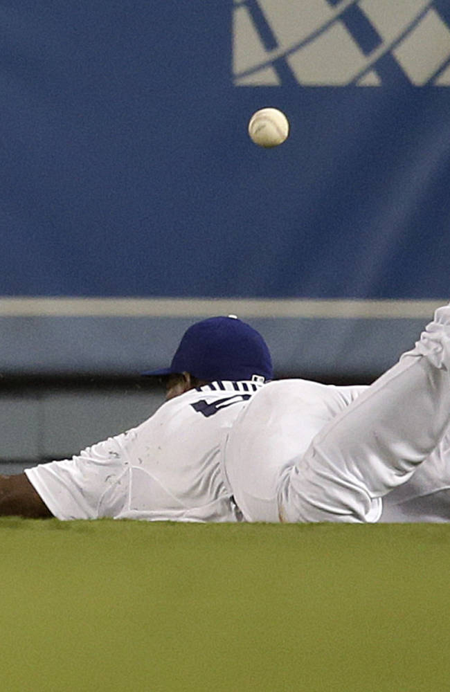 Los Angeles Dodgers' Yasiel Puig misses the ball hit by Arizona Diamondbacks' Eric Chavez during the seventh inning a baseball game on Monday, Sept. 9, 2013, in Los Angeles