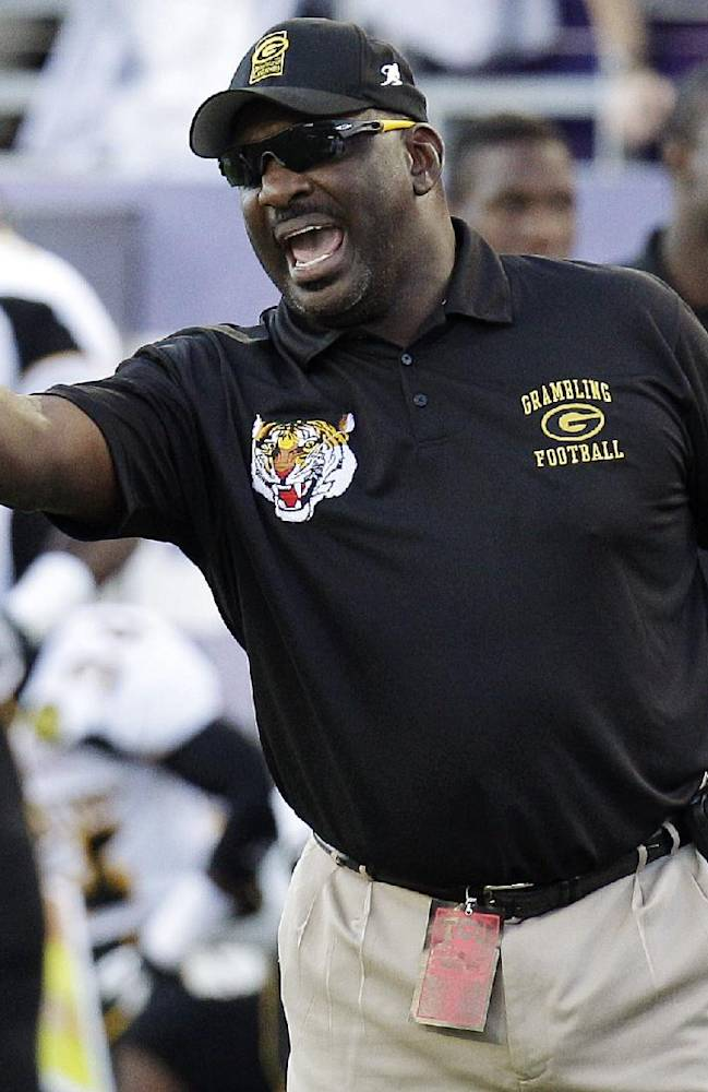 In this Sept. 8, 2012, file photo, Grambling State head coach Doug Williams yells from the sideline during the first half of an NCAA college football game against TCU in Fort Worth, Texas. Grambling State announced Wednesday, Sept. 11, 2013, that they fired Williams, and bought out the remainder of his contract after the team lost its first two games of the season